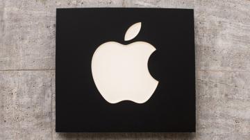 Logo da Apple fixado em uma parde
