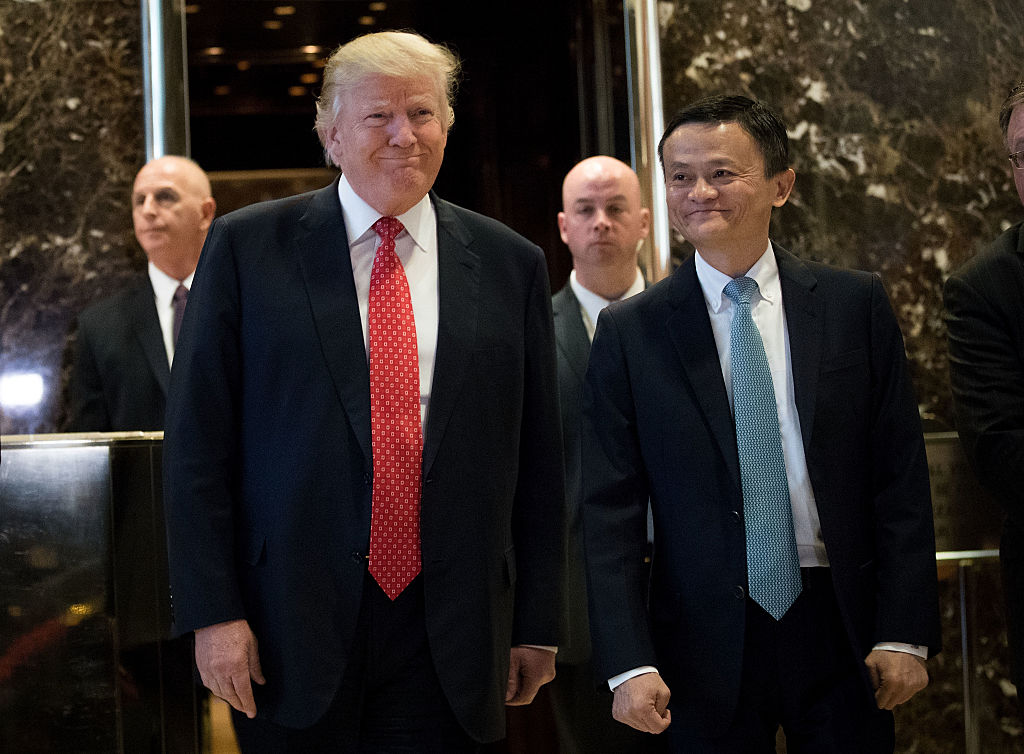 NEW YORK, NY - JANUARY 9: (L to R) President-elect Donald Trump and Jack Ma, Chairman of Alibaba Group, emerge from the elevators to speak to reporters following their meeting at Trump Tower, January 9, 2017 in New York City. President-elect Donald Trump and his transition team are in the process of filling cabinet and other high level positions for the new administration. (Photo by Drew Angerer/Getty Images)