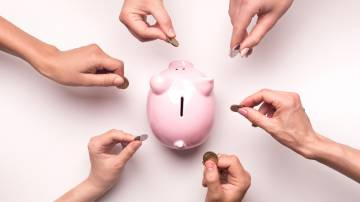 People hands throwing coins in piggy bank for crowdfunding