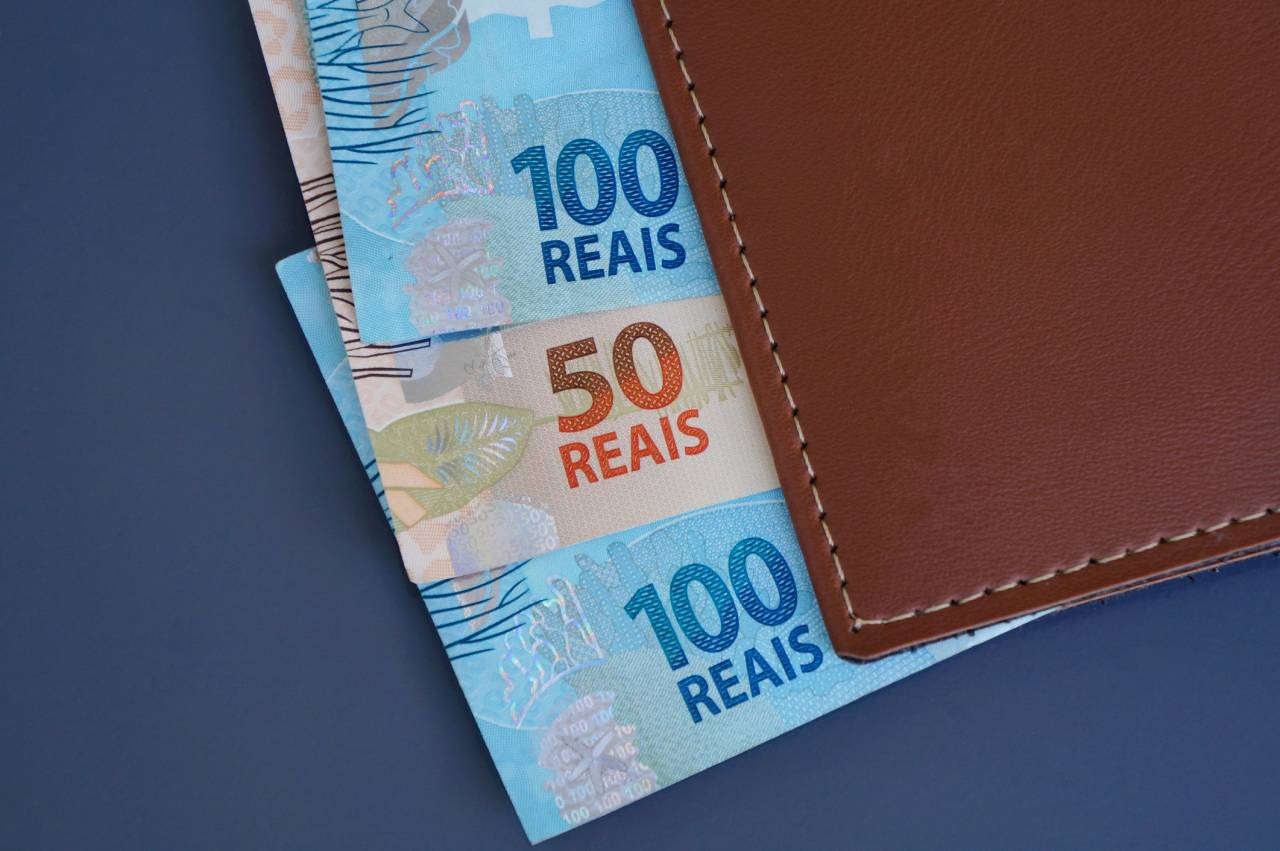 Brazilian money on a wallet. Brazilian economy concept.