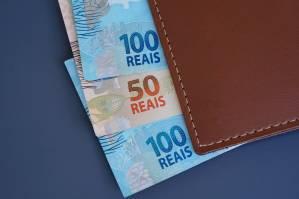 Brazilian money on a wallet. Brazilian economy concept.