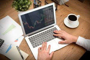 Broker or investor analyzing chart in office